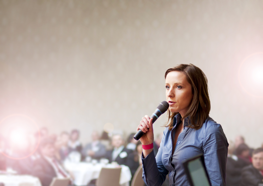 20140917we-woman-presenting-conference-sypmosium-shutterstock_115648075